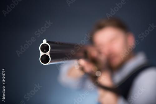 Fotografia Office worker holding a shotgun