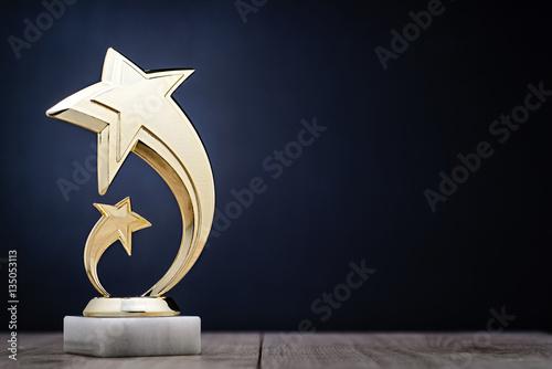 Canvas Print Elegant winners trophy with shooting stars
