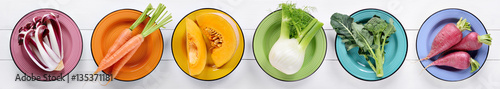 Colorful vegetables collection on white wooden background, top view, flat lay.
