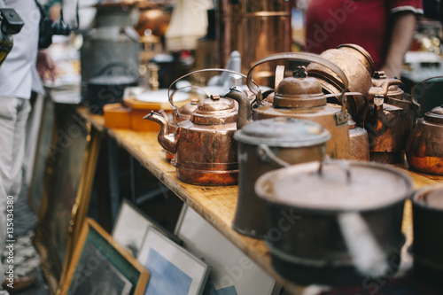 Obraz na plátně antique pans and pots at the street market in sweden