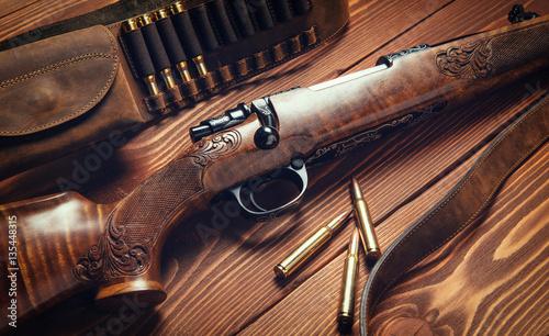 Obraz na plátně Hunting equipment on old wooden background