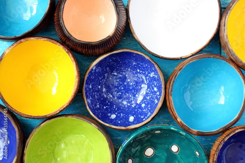 Fényképezés Many different bright multicolored ceramic bowls and cups handcrafted