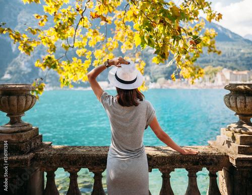 Fototapeta Young woman relaxing on beautiful Garda lake
