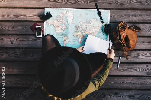 Photo Tourist exploring the world map.