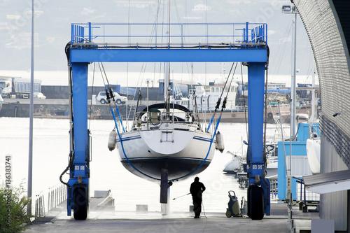 Fotografie, Obraz sailboat  in shipyard  for repair and maintenance in marina port