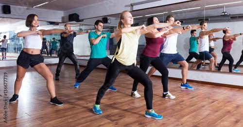 Men and ladies dancing zumba Fototapeta