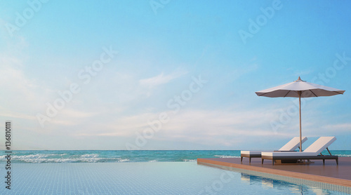 Tableau sur Toile Pool terrace with sea view 3d rendering image,A place surrounded by the sea ,The