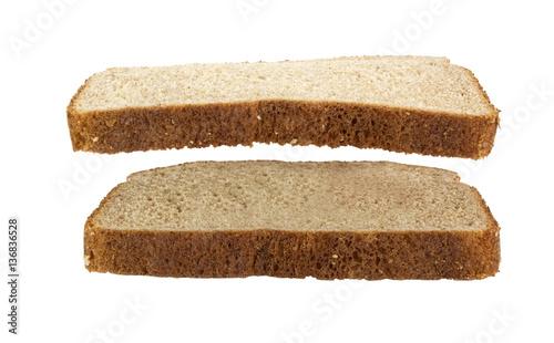 Foto Slice of wheat bread suspended over another slice of wheat bread