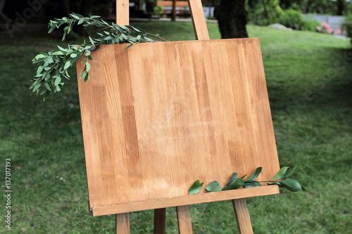 Wooden easel with a board. Fototapeta
