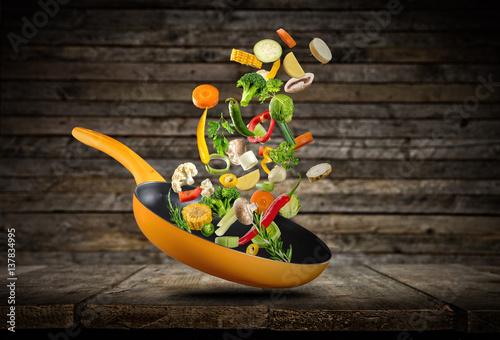 Fotografie, Obraz Fresh vegetables flying into a pan
