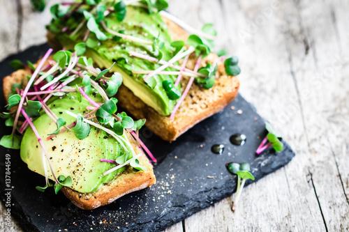 Delicious vegan sandwich with avocado and radish cress