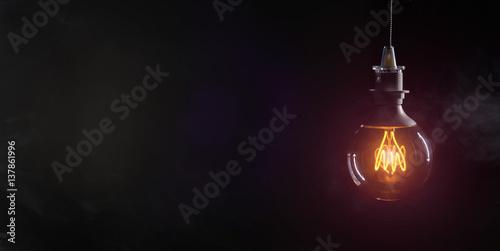 Carta da parati Vintage lightbulb on dark background