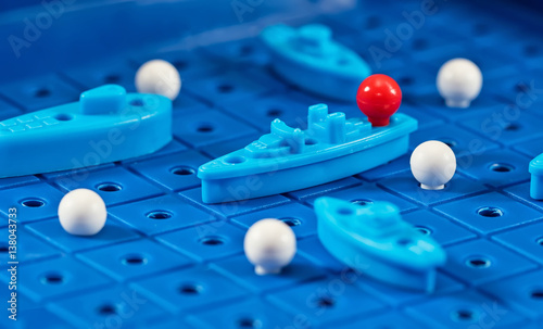 Fotografía Toy war ships and submarine are placed on the blue  playing Board