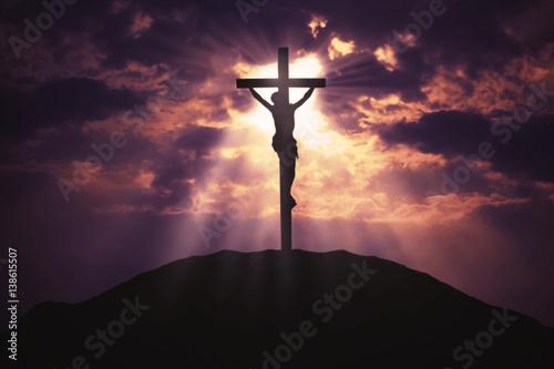 Leinwand Poster Christian cross on hill at sunrise