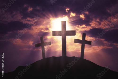 Foto Three crosses symbol on hill
