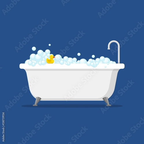 Bathtub with foam bubbles inside and bath yellow rubber duck isolated on blue background Fototapete