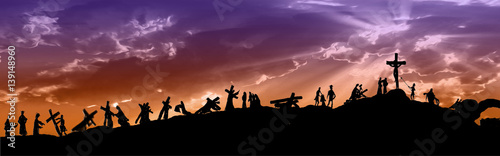Foto Way of the cross or stations of the cross silhouettes of Jesus Christ carrying his cross on Calvary hill, with cloudy dark sky and sun light rays