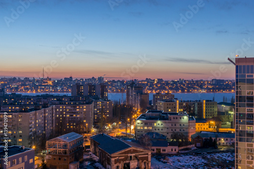 Night Voronezh city after sunset, blue hour, night lights of houses, buildings,