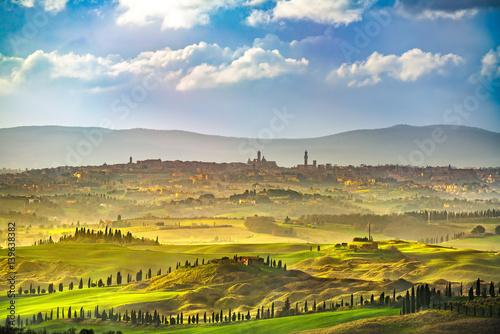 Fotografie, Obraz Siena city skyline, countryside and rolling hills. Tuscany, Italy
