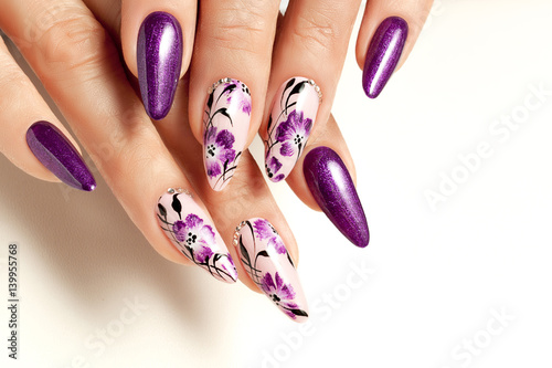 Canvas Print Nail art service. Female manicure and floral patterns.