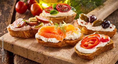 Fotografia, Obraz Selection of tasty bruschetta or canapes