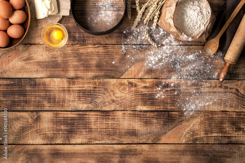 Canvas-taulu Flour with ingredients for bakery products on wooden background