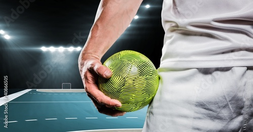 Close-up of handball player holding ball in his hand