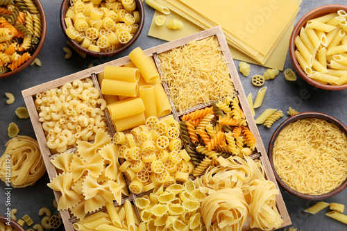 Valokuvatapetti Different kinds of pasta on grey wooden table