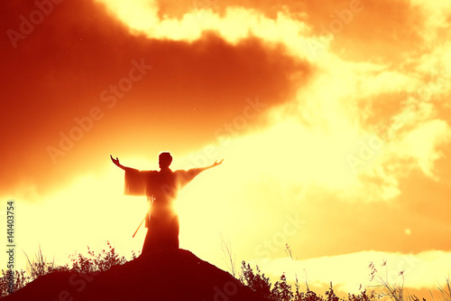 Fotografie, Obraz Silhouette monk on the mountain prayer moses faith god