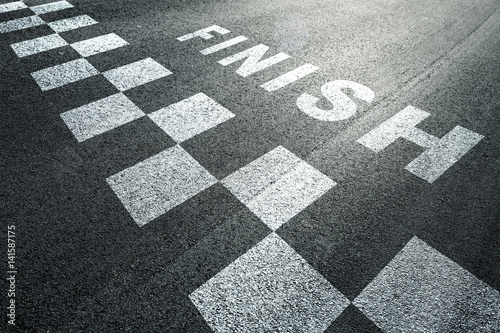 Sunny finish line pattern racing background on the asphalt floor.