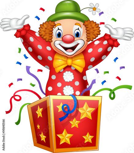Vászonkép Cartoon clown jumping out of the box