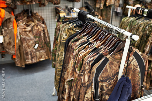 Clothes for hunting and fishing in store