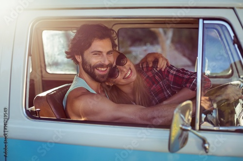 Canvas Print Couple sitting in a campervan