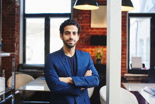 Slika na platnu Portrait of an Arab businessman in a jacket in the office