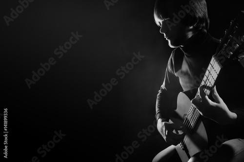 Fototapeta Acoustic guitar player guitarist playing classical guitar