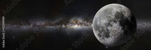 Obraz na plátně Moon in front of the Milky Way galaxy
