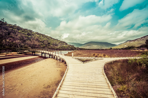 Wooden footbridge across Tidal River Fototapet