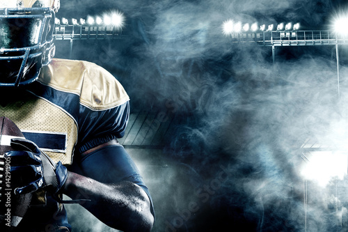 Photo American football sportsman player on stadium with lights on background with cop