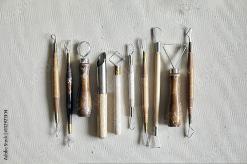Fotografie, Tablou Ceramic working process with clay and tools for hand-crafted work