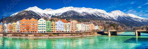 Fototapeta City scape in Innsbruck city center with beautiful houses, river Inn and Tyrolian Alps, Austria, Europe
