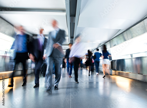 Photographie People rushing in the lobby. motion blur