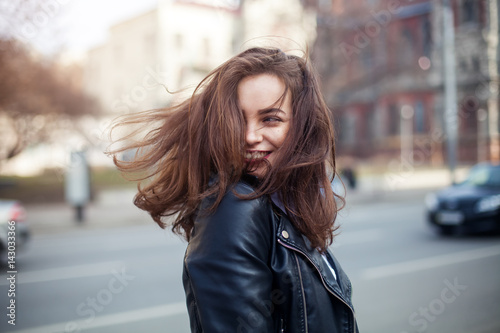 Canvas-taulu young beautiful brunette walking the city