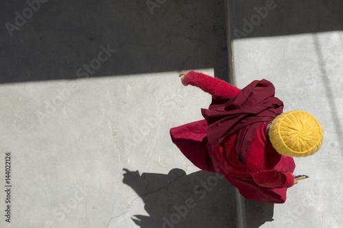 Buddhist monk in traditional robe at tibetan monastery in Leh Ladakh, Kashmir, I Fototapeta