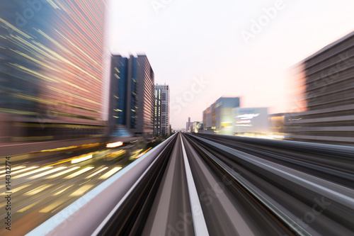rail track and cityscape of tokyo from speed train