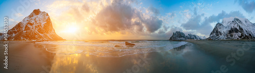 sunrise in arctic sea and mountain in horizon
