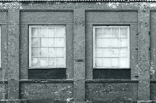 brick wall of an old factory with windows