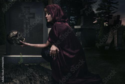 Obraz na płótnie Beautiful sorceress in creepy cemetary. Fantasy concept.