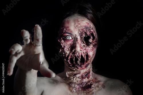 Fényképezés horrible scary zombie girl on black background with copyspace
