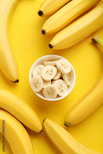 Sweet bananas on the yellow background