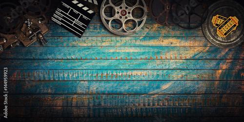 Cinema concept of vintage film reels, clapperboard and projector.